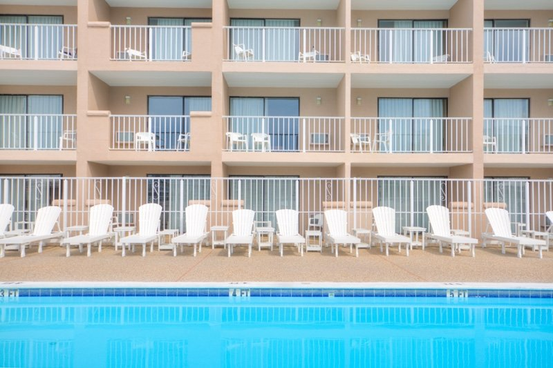hotel with pool and chairs