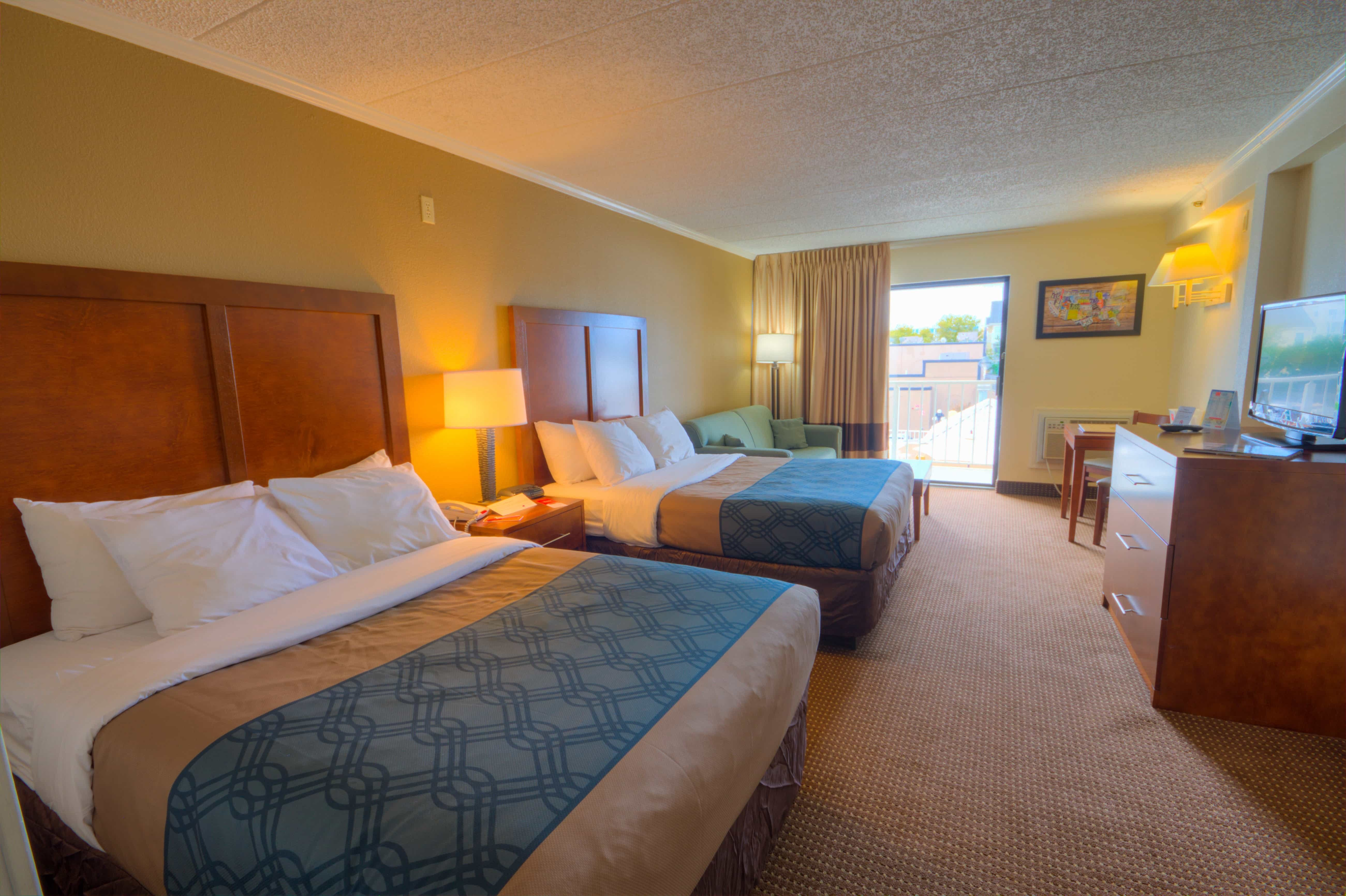 Two double beds in a clean hotel room in ocean city Maryland